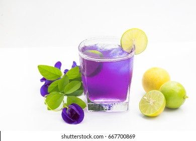 Healthy herbal beverage Anchan flower,butterfly pea flower with lemon juice (Clitoria ternatea) on white background