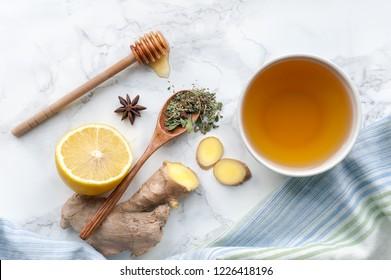Healthy herbal tea on marble table. Top view.