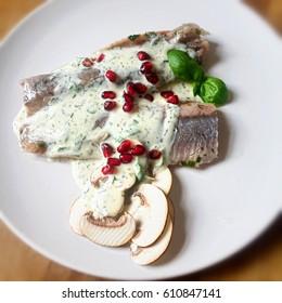 Healthy herring wit mushrooms cranberries and herb yoghurt dressing