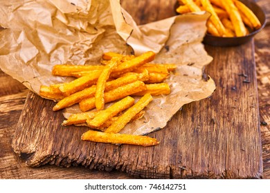 Healthy Homemade Baked Sweet Potato Fries with Ketchup. Crisp golden deep fried french fries; hot potatoes frying and ready to be eaten... yum!