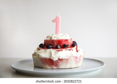 Healthy homemade birthday cake for the first birthday. Made of watermelon, blueberries and unsweetened cream.
