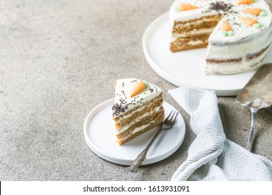 Healthy homemade carrot cake with cream cheese frosting on light stone background