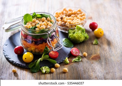 Healthy homemade chickpea and veggies salad in jar, diet, vegetarian, vegan food, vitamin snack