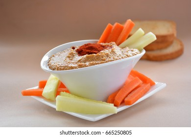 Healthy Homemade Creamy Hummus with carrots