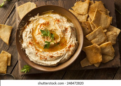 Healthy Homemade Creamy Hummus with Olive Oil and Pita Chips