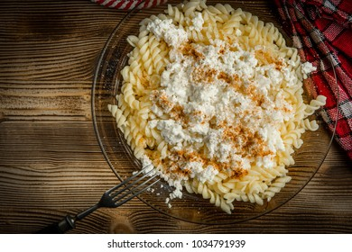 Healthy homemade food. Fusilli pasta with cottage cheese, sugar and cinnamon.
