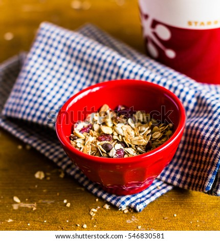 Healthy homemade granola or muesli with oats, dried pears, raisin, almonds, hazelnuts