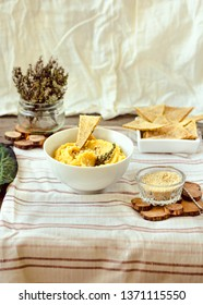 Healthy Homemade Hummus with turmeric and rosemary on a rustic wooden table. Thanksgiving Appetizer dip.Selective focus.