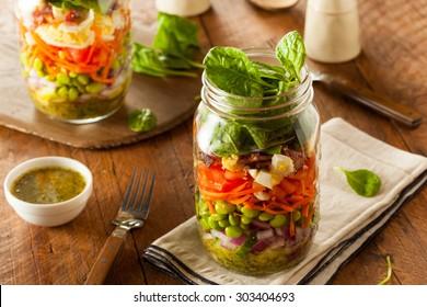 Healthy Homemade Mason Jar Salad with Egg Bacon Lettuce and Veggies