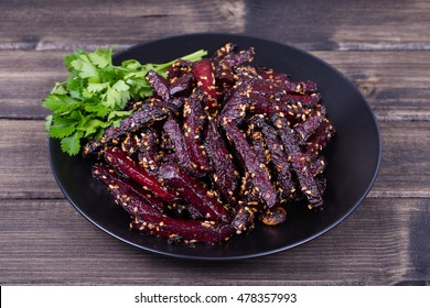 Healthy homemade roasted beetroot ready to eat in black plate, close up