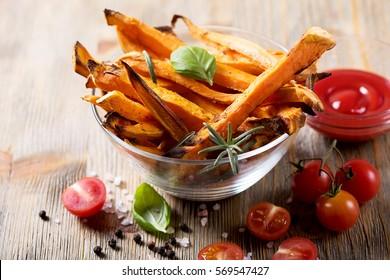 Healthy homemade sweet potato fries, vegan vegetarian snack with ketchup