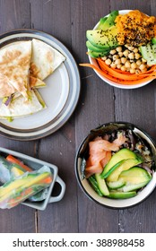 Healthy ideas for lunch - quesadilla, spring rolls, bowls with vegetables, salmon and avocado