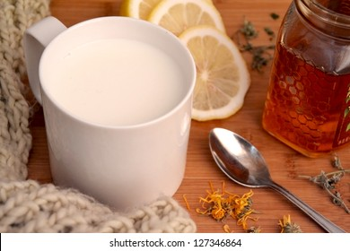 Healthy ingredients for strengthening immunity with warm scarf close-up. herbal home remedy for colds