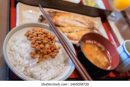 Healthy Japanese breakfast with Miso soup, grilled fish, rice and fermented soy beans called Natto in Japan