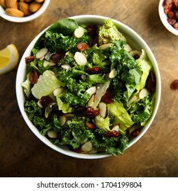 Healthy kale salad with almond and cranberry