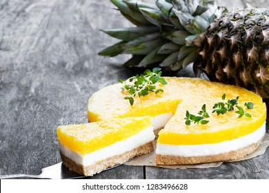 Healthy  layered pineapple cheese cake on wooden table
