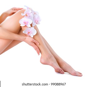 Healthy Legs. Spa. Skincare. Long woman legs and Hands isolated on white