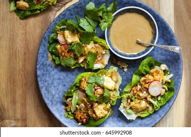 Healthy lettuce wrap with vegetables, tofu and peanut sauce