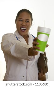 Healthy life, healthy choices.   Healthy Choices - Ethnic doctor, nurse or dietician, holding a fresh juice