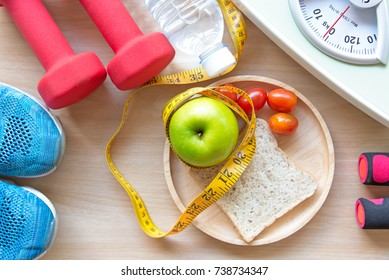 Healthy Life for Diet. Green apple and Weight scale,measure tap with clean water and sport equipment for women eat slimming.  Diet and Healthy Concept.