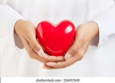 Healthy life and valentine's day - person holding a heart symbol