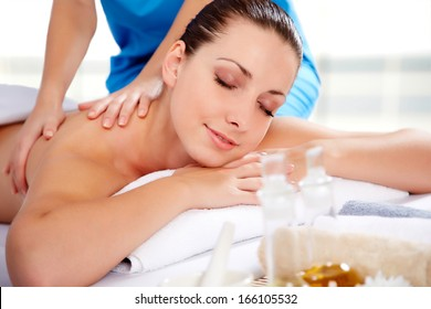 Healthy life. Young beautiful woman relaxed in spa environment