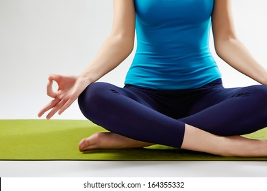 Healthy life. Young  woman doing yoga isolated on white background.
