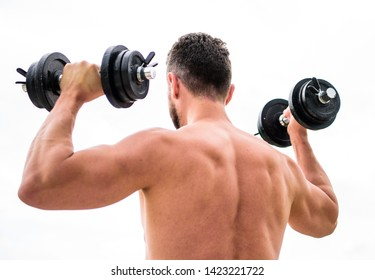 Healthy lifestyle. athletic body. Dumbbell gym. fitness and sport equipment. man sportsman weightlifting. steroids. Muscular back man exercising in morning with barbell. Working his core muscles.