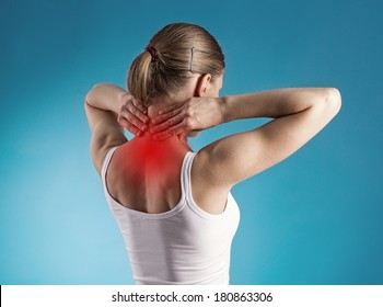 Healthy lifestyle. Back and spine disease. Close-up portrait of tired female massaging her neck.