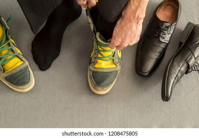 Healthy lifestyle balance concept. Businessman change shoes on sneakers.