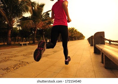 healthy lifestyle beautiful asian woman running at  sunrise seaside