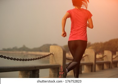healthy lifestyle beautiful asian woman running at sunrise seaside