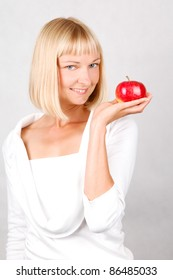 Healthy Lifestyle/ Beautiful Young Woman holding an apple
