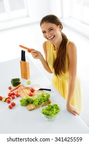 Healthy Lifestyle And Diet. Portrait Of Happy Smiling Woman Preparing Fresh Organic Food In Kitchen, Cooking Vegetarian Salad. Healthy Food And Eating.  Healthcare. Health, Beauty Concept. Nutrition.