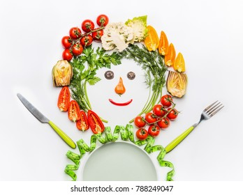 Healthy lifestyle and dieting concept. Friendly Man made of salad vegetables , plate, cutlery and measuring tape on white desk background, top view. Clean food and vegetarian eating