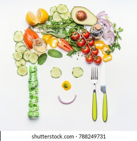Healthy lifestyle and dieting concept. Friendly face made of various salad vegetables, cutlery and measuring tape on white desk background, top view. Clean food and vegetarian eating