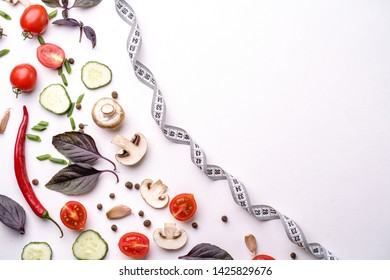 healthy lifestyle, dieting, weight loss, balanced food. seasonal summer vegetables and measure tape. diet and fitness blog design concept