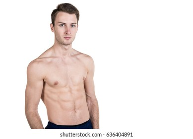 Healthy lifestyle and fitness. Handsome guy sports physique, with a naked body, on the left side of the frame, isolated on a white background