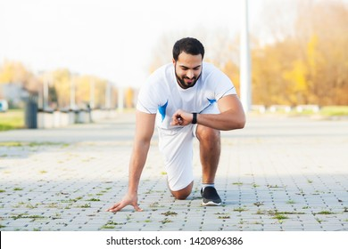 Healthy lifestyle. Fitness man doing exercise in city environment