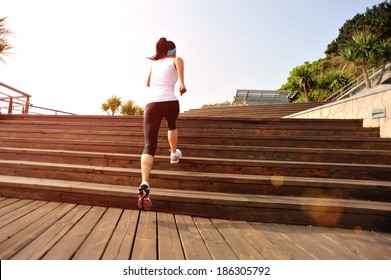 healthy lifestyle fitness sports woman running on wooden stairs