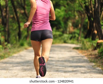 healthy lifestyle fitness sporty  woman runner running in forest trail