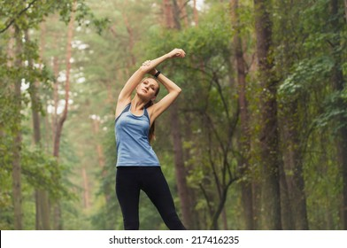 healthy lifestyle fitness sporty woman stretching before run early in the morning in forest area