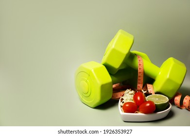 Healthy lifestyle and food concept.Sporty lifestyle. Workouts. Vegetables, fruits are near dumbbells.