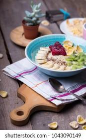 healthy lifestyle. healthy food - oatmeal with banana, kiwi and raspberries