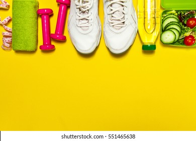 Healthy lifestyle, food, sport or athlete's equipment on bright background. Flat lay. Top view with copy space.