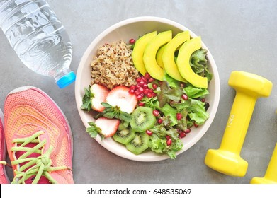 Healthy lifestyle, food and sport on cement background.