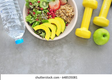Healthy lifestyle, food and sport on cement background. Flat lay. Top view with copy space.