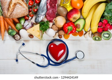 Healthy lifestyle and healthcare concept. Healthy food, heart and stethoscope