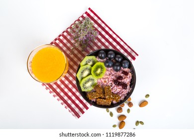 Healthy lifestyle, mix of energy fruits and dried nuts in cup, breakfast or morning snack concept, isolated on white background.