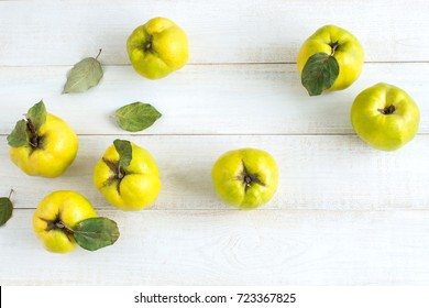 healthy lifestyle, nutrition, treatment concept. top view of lemon yellow fruits picked up from quince tree, they are lying on the table of perfect white surface of table